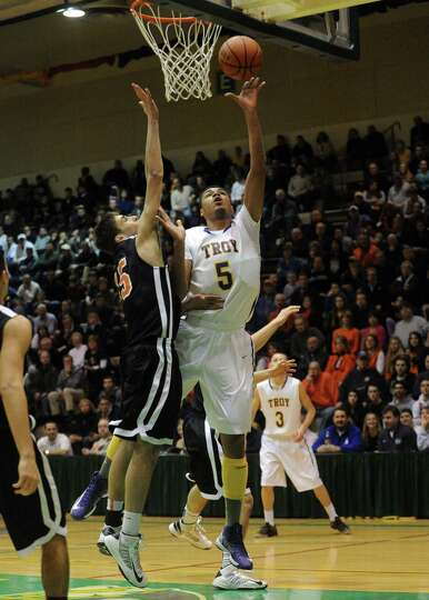 Troy's Javon Ogunyemi goes in for a score during their boy's high school basketball game against Bet