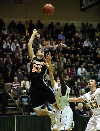 Bethlehem's Conner Morelli puts up a shot during their boy's high school basketball game against Tro