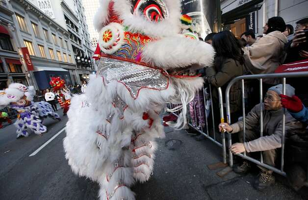 The West Coast Lion Dance Troupe entertains the crowd as San Francisco's Chinese New Year parade makes it's way through downtown on Saturday Feb. 23, 2013. Photo: Michael Macor, The Chronicle