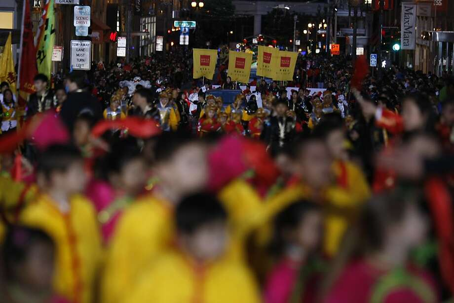Parade participants pass Kearny St. during the Chinese New Year Parade held on Saturday, Feb. 23. Photo: James Tensuan, The Chronicle