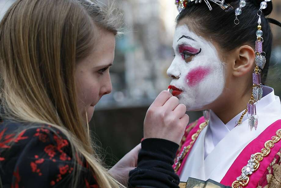 Kasandra Luna of West Portal Elementary school gets her make up done by Jacquelyn McDonald before participating in the Chinese New Year Parade on Saturday, Feb. 23. Photo: James Tensuan, The Chronicle