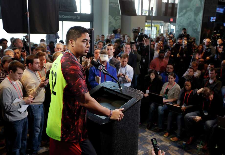 Notre Dame linebacker Manti Te'o answers a question during a news conference at the NFL football scouting combine in Indianapolis, Saturday, Feb. 23, 2013. (AP Photo/Michael Conroy) Photo: Michael Conroy