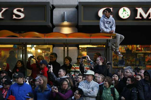 Parade-goers react to the festivities on Market St. during the Chinese New Year Parade on Saturday, Feb. 23. Photo: James Tensuan, The Chronicle