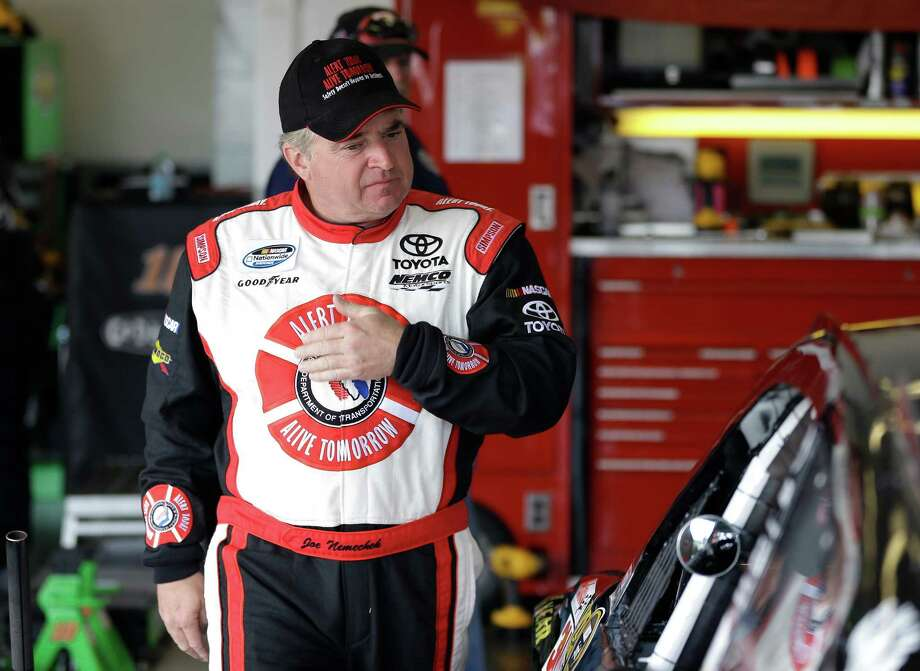Joe Nemechek gets ready to climb into his car during a practice for the Daytona 500 NASCAR Sprint Cup Series auto race Friday, Feb. 22, 2013, at the Daytona International Speedway in Daytona Beach, Fla. (AP Photo/Chris O'Meara) Photo: Chris O'Meara
