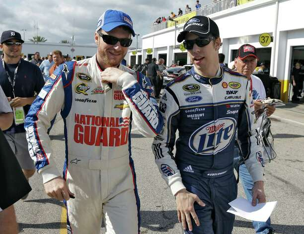 Dale Earnhardt Jr., left, and Brad Keselowski walk through the garage area during a NASCAR Sprint Cup Series auto racing practice Saturday, Feb. 23, 2013, at the Daytona International Speedway in Daytona Beach, Fla. (AP Photo/Chris O'Meara) Photo: Chris O'Meara