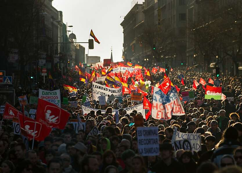 MADRID, SPAIN - FEBRUARY 23:  Demonstrators protest on Calle Alcala during a march by thousands of p