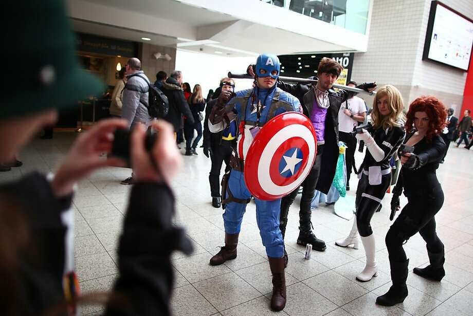 LONDON, ENGLAND - FEBRUARY 23:  Enthusiasts in costume pose for a photo at the London Super Comic Convention at the ExCeL Centre on February 23, 2013 in London, England. Enthusiasts at the Comic Convention are encouraged to wear a costume of their favourite comic character and flock to the ExCeL to gather all the latest news in the world of comics, manga, anime, film, cosplay, games and cult fiction.  (Photo by Jordan Mansfield/Getty Images) *** BESTPIX *** Photo: Jordan Mansfield, Getty Images
