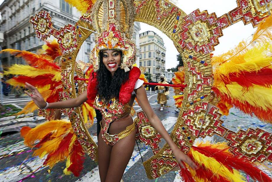 "A dancer performs during the Nice Carnival parade on February 23, 2013 in Nice, southeastern France. The Carnival, starting from February 15 until March 6, 2013, will celebrate the ""King of the five continents"", marking the 140th anniversary of the French Riviera Nice carnival.    TOPSHOTS /  AFP PHOTO / VALERY HACHEVALERY HACHE/AFP/Getty Images Photo: Valery Hache, AFP/Getty Images"