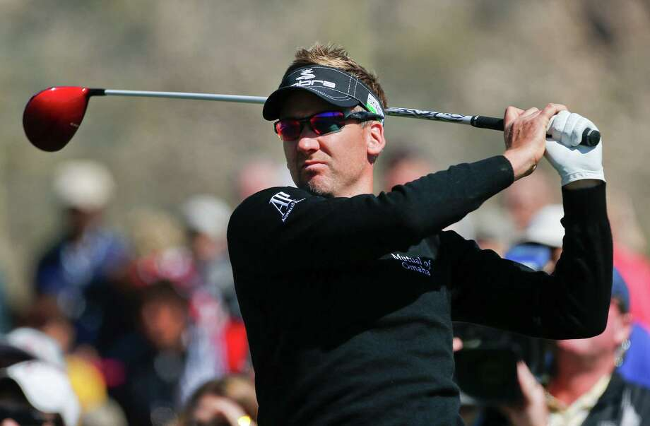 England's Ian Poulter tees off the third hole in the quarterfinal round of play against Steve Stricker at the Match Play Championship golf tournament, Saturday, Feb. 23, 2013, in Marana, Ariz. (AP Photo/Ross D. Franklin) Photo: Ross D. Franklin