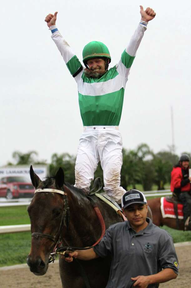 In this image provided by Hodges Photography, jockey James Graham celebrates aboard Ive Struck A Nerve after winning the 40th running of the Grade II Risen Star Stakes horse race at Fair Grounds Race Course Saturday, Feb. 23, 2013, in New Orleans  (AP Photo/Hodges Photography, Jamie Hernandez) Photo: Jamie Hernandez