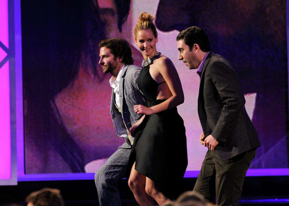 Actor Bradley Cooper, actress Jennifer Lawrence and producer Jonathan Gordon accept the award for best feature for