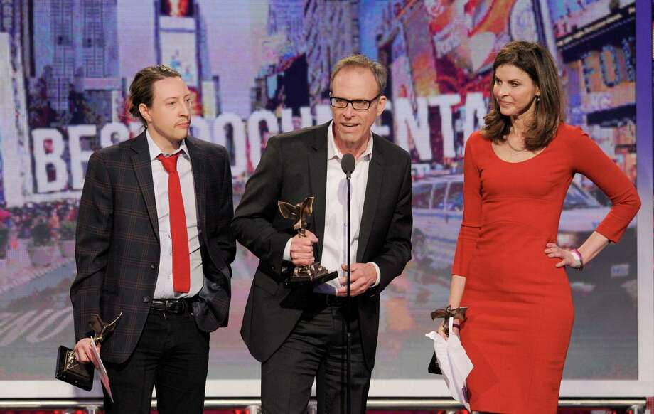 "Producer Tanner King Barklow, producer Amy Ziering and director Kirby Dick accept the award for best documentary for ""the Invisible War."" Photo: Chris Pizzello/Invision/AP"