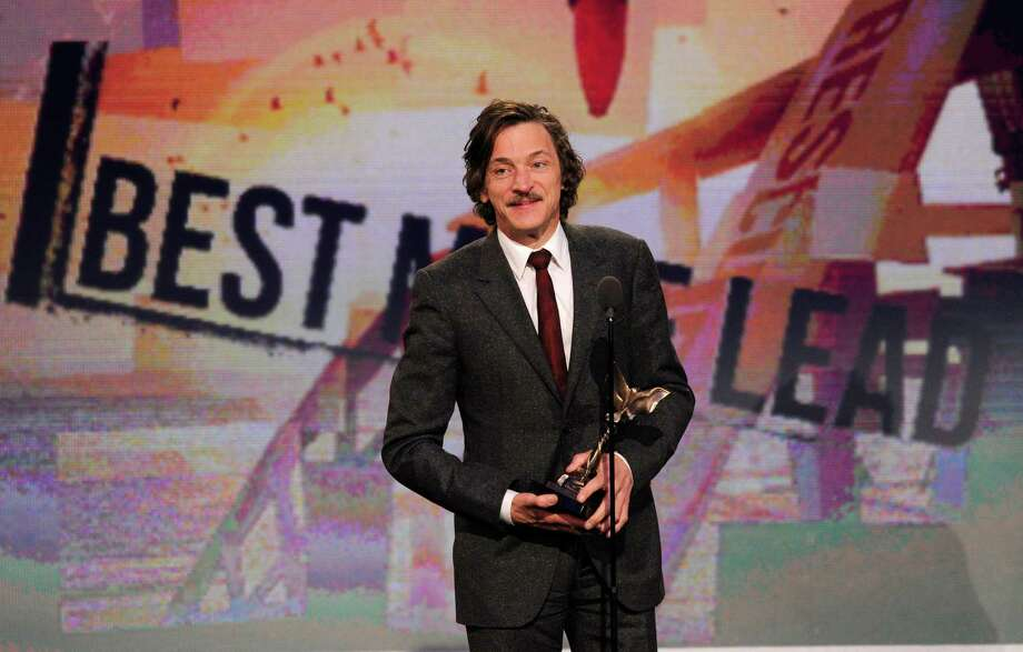 "Actor John Hawkes accepts the award for best male lead for ""The Sessions."" Photo: Chris Pizzello/Invision/AP"