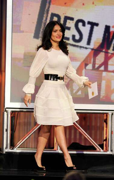 Actress Salma Hayek presents the award for best male lead.