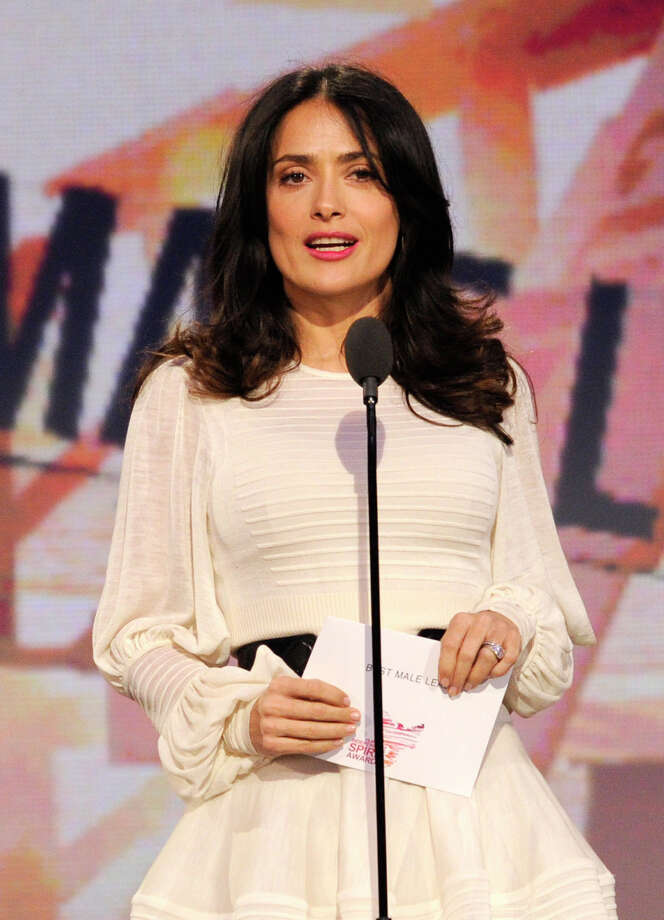 Actress Salma Hayek presents the award for best male lead. Photo: Chris Pizzello/Invision/AP