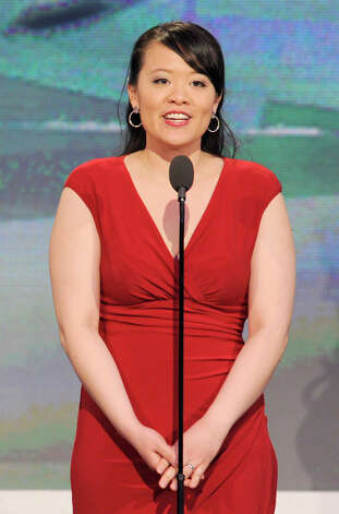 Producer Mynette Louie speaks onstage. Photo: Chris Pizzello/Invision/AP