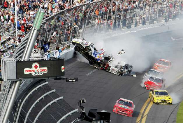 Kyle Larson's car (32) gets airborne during a multi-car wreck on the final lap of the NASCAR Nationwide Series auto race Saturday, Feb. 23, 2013, at Daytona International Speedway in Daytona Beach, Fla. Tony Stewart, in the red car at front, won the race. (AP Photo/David Graham) Photo: David Graham