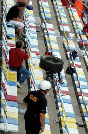 A tire rests in the stands after a crash at the conclusion of the NASCAR Nationwide Series auto race Saturday, Feb. 23, 2013, at Daytona International Speedway in Daytona Beach, Fla. Driver Kyle Larson's car hit the safety fence sending car parts and other debris flying into the stands injuring spectators. (AP Photo/David Graham) Photo: David Graham