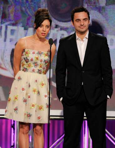Presenters Aubrey Plaza, left, and Jake Johnson speak onstage. Photo: Chris Pizzello/Invision/AP