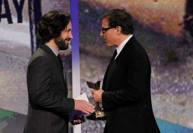 "Actor Paul Rudd presents director David O. Russell with the award for best screenplay for ""Silver Linings Playbook."" Photo: Chris Pizzello/Invision/AP"