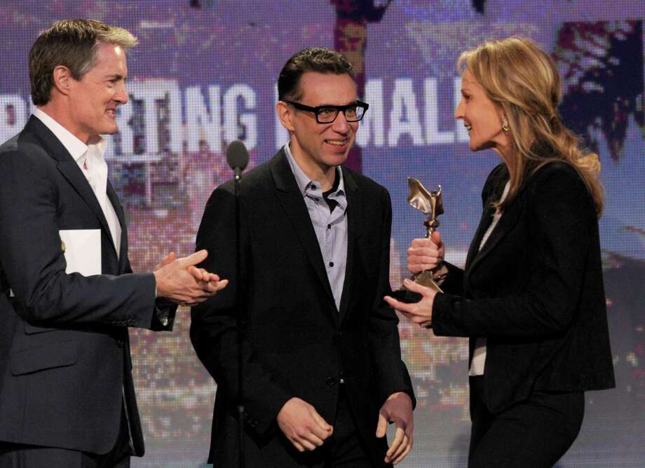 "Actors Kyle MacLachlan, left, and Fred Armisen, center, present Helen Hunt with the award for best supporting female for ""The Sessions."" Photo: Chris Pizzello/Invision/AP"
