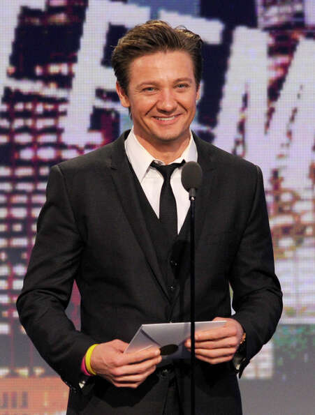 Actor Jeremy Renner presents the award for best female lead.