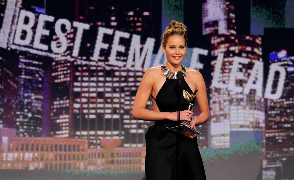 Actress Jennifer Lawrence accepts the award for best female lead for