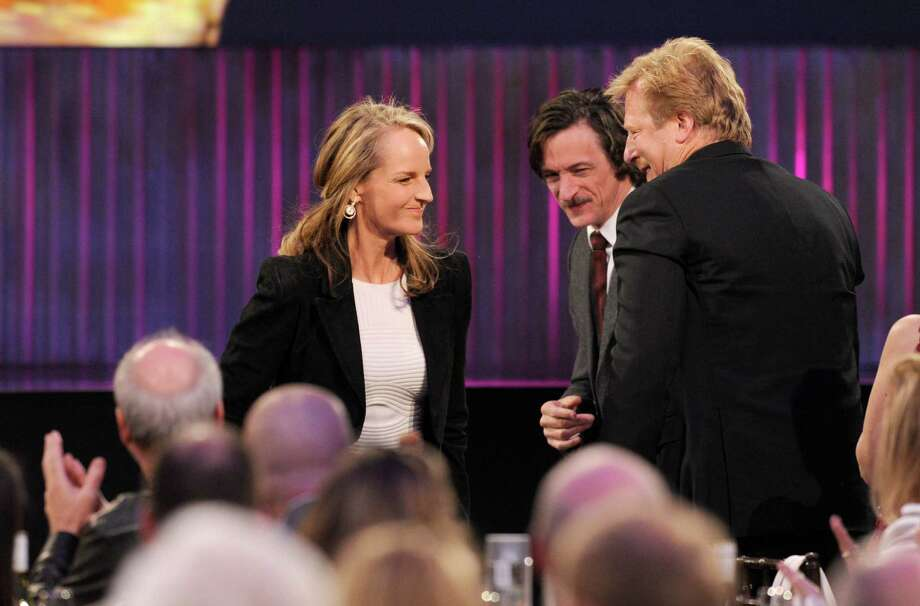 "Actress Helen Hunt accepts the award for best supporting female for ""The Sessions."" At center is her co-star from the film, John Hawkes. Photo: Chris Pizzello/Invision/AP"
