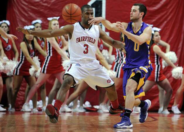 Albany's Jacon Iati passes the ball during game action against Fairfield University Saturday, Feb. 23, 2013 at the Webster Bank Arena in Bridgeport, Conn. Photo: Autumn Driscoll / Connecticut Post