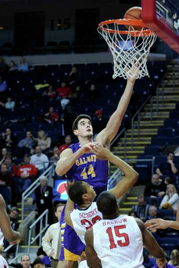 Albany's John Puk puts up the ball as Fairfield's Marcus Gilbert defends Saturday, Feb. 23, 2013 at