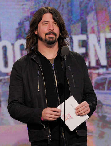 Presenter Dave Grohl presents the award for best documentary. Photo: Chris Pizzello/Invision/AP