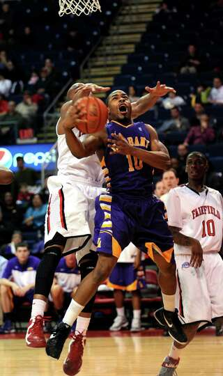 Albany's Mike Black gets fouled by Fairfield's Keith Matthews as he goes up for a shot during the se