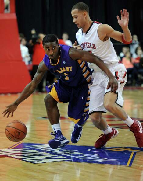 Albany's DJ Evans drives the ball down the court as Fairfield's Colin Nickerson defends Saturday, Fe