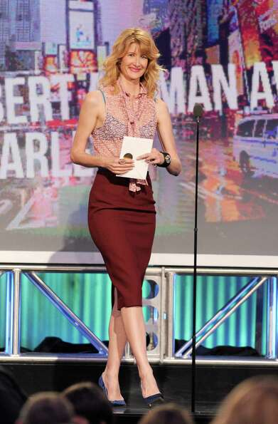 Actress Laura Dern speaks onstage.