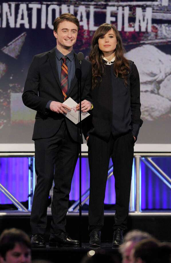 Actors Daniel Radcliffe, left, and Ellen Page present  the award for best international film. Photo: Chris Pizzello/Invision/AP