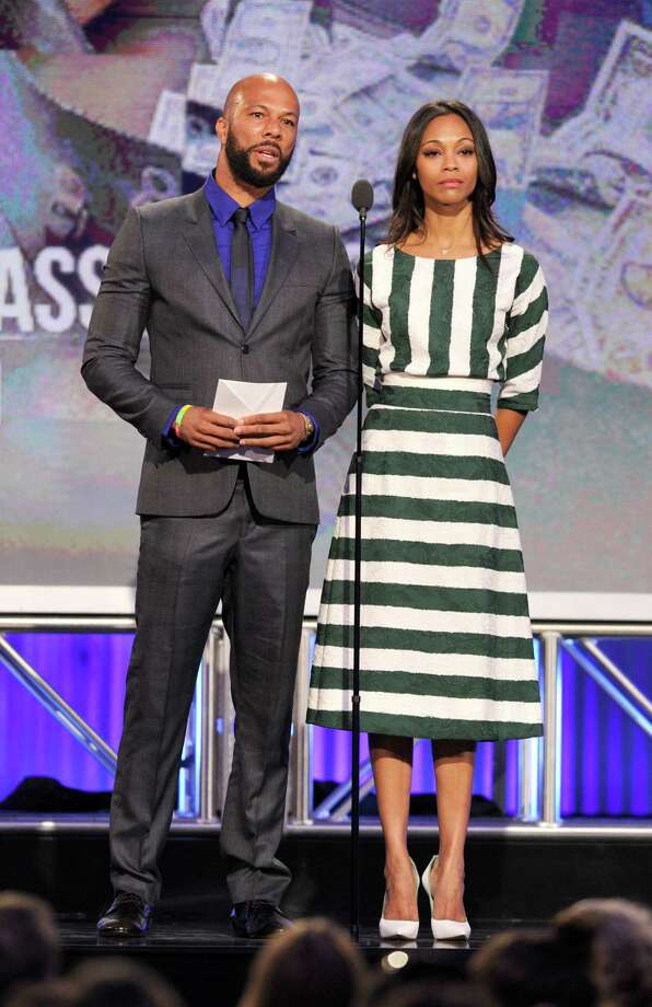 Common, left, and actress Zoe Saldana present the John Cassavetes award. Photo: Chris Pizzello/Invision/AP
