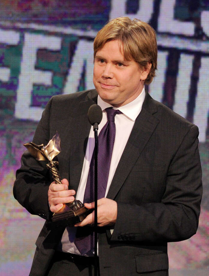 "Director Stephen Chbosky accepts the award for best first feature for ""The Perks of Being a Wallflower."" Photo: Chris Pizzello/Invision/AP"