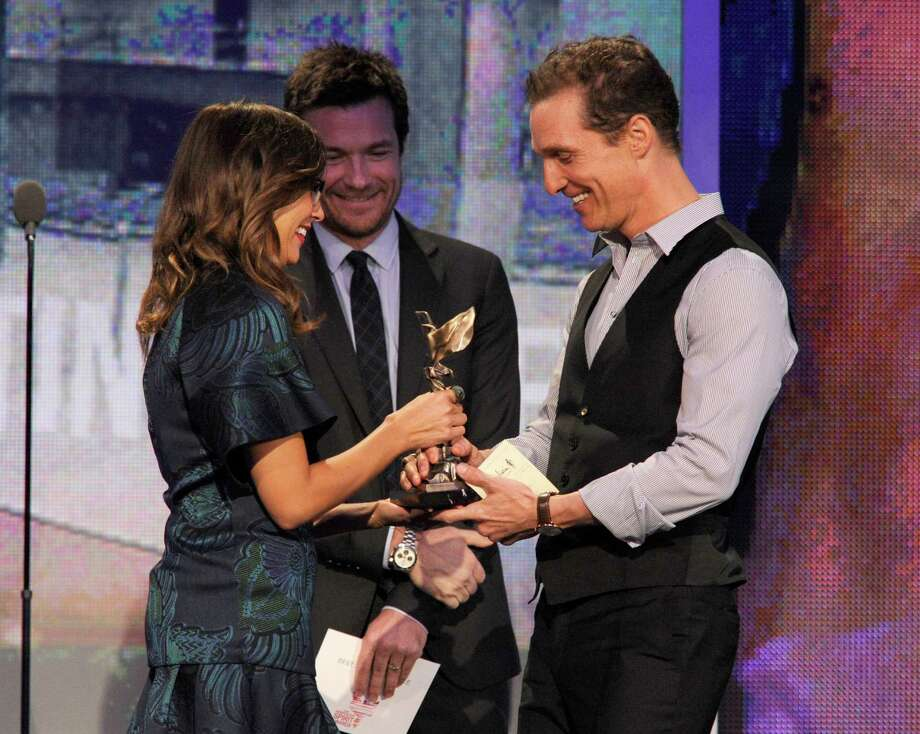 "Actors Rashida Jones, left, and Jason Bateman present actor Matthew McConaughey, right, the award for best supporting male for ""Magic Mike."" Photo: Chris Pizzello/Invision/AP"