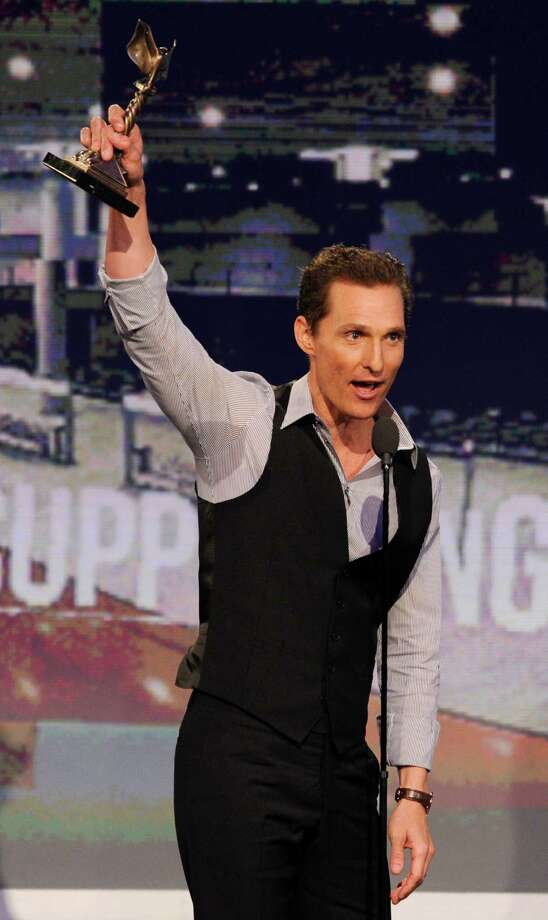 "Actor Matthew McConaughey accepts the award for best supporting male for ""Magic Mike,."" Photo: Chris Pizzello/Invision/AP"