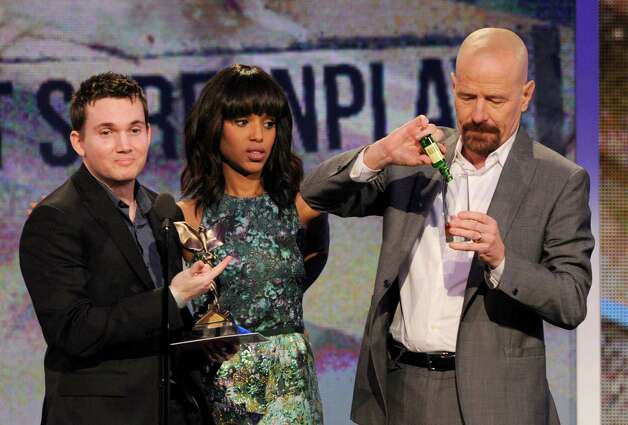 Actors Kerry Washington, center, and Bryan Cranston, right, present Derek Connolly with the best first screenplay award. Photo: Chris Pizzello/Invision/AP