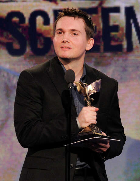 Derek Connolly accepts the best first screenplay award.