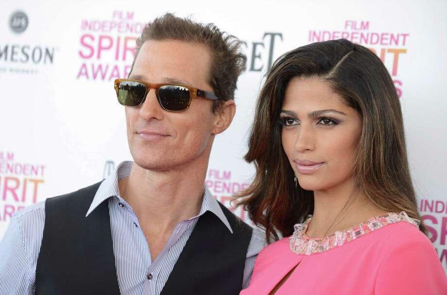 Actor Matthew McConaughey, left, and Camila Alves arrive. Photo: Jordan Strauss/Invision/AP