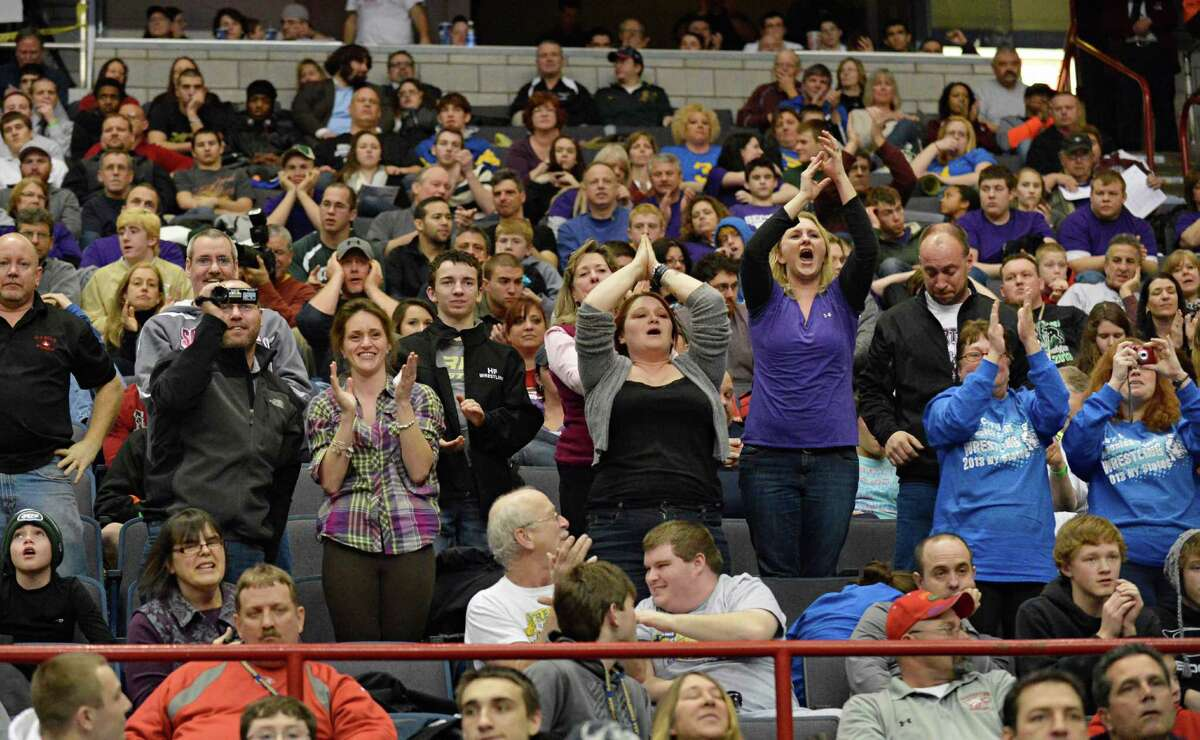 Fans cheer Hoosick Falls' Luis Weierbach as he wins the 106 lb. final at the state wrestling tournament at the Times Union Center in Albany Saturday Feb. 23, 2013. (John Carl D'Annibale / Times Union)