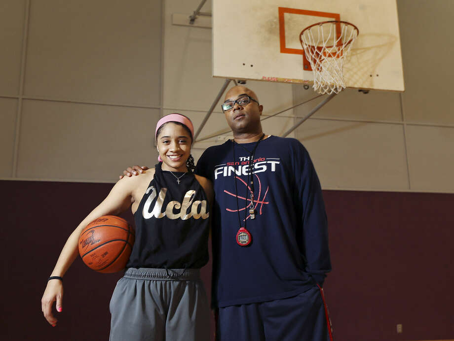 With the help of her father, Ray, former Johnson standout Recee' Caldwell is aiming for college and the WNBA. Photo: Edward A. Ornelas / San Antonio Express-News