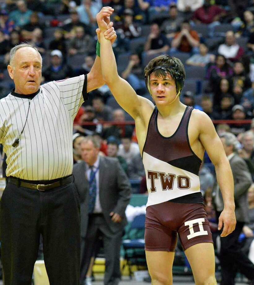 Shen's Nick Kelley, has his hand raised in victory after beating Vincent Deprez of Hilton in the 138 lb. final match at the state wrestling tournament at the Times Union Center in Albany Saturday Feb. 23, 2013.  (John Carl D'Annibale / Times Union) Photo: John Carl D'Annibale / 00021229A