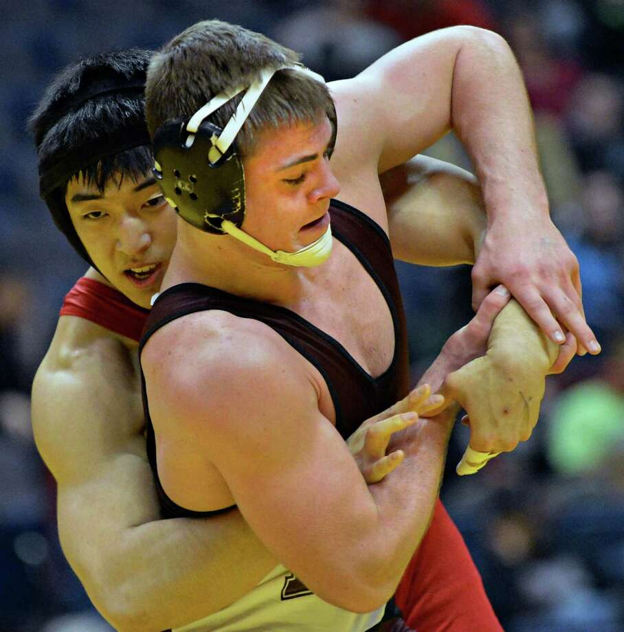 Dan Choi, left, of Syosset,  wrestles Shen's Levi Ashley in the 195 lb. final match at the state wrestling tournament at the Times Union Center in Albany Saturday Feb. 23, 2013.  (John Carl D'Annibale / Times Union) Photo: John Carl D'Annibale / 00021229A