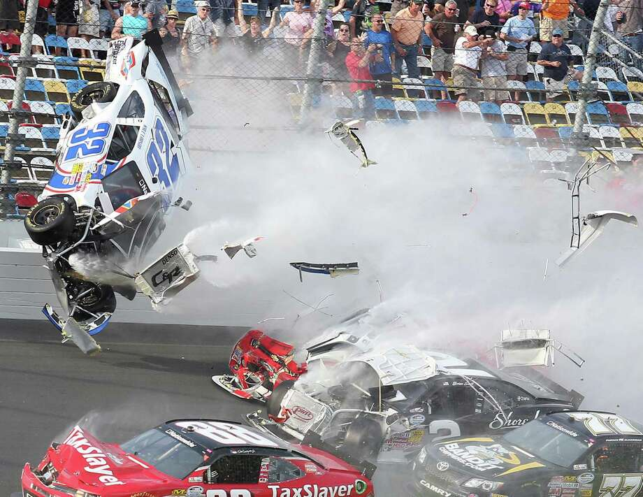 A spectacular crash sends the car of Kyle Larson (32) hurtling toward the fence and crowd on the last lap of the Nationwide Series race Saturday at Daytona International Speedway. Photo: Stephen M. Dowell, MBR / Orlando Sentinel