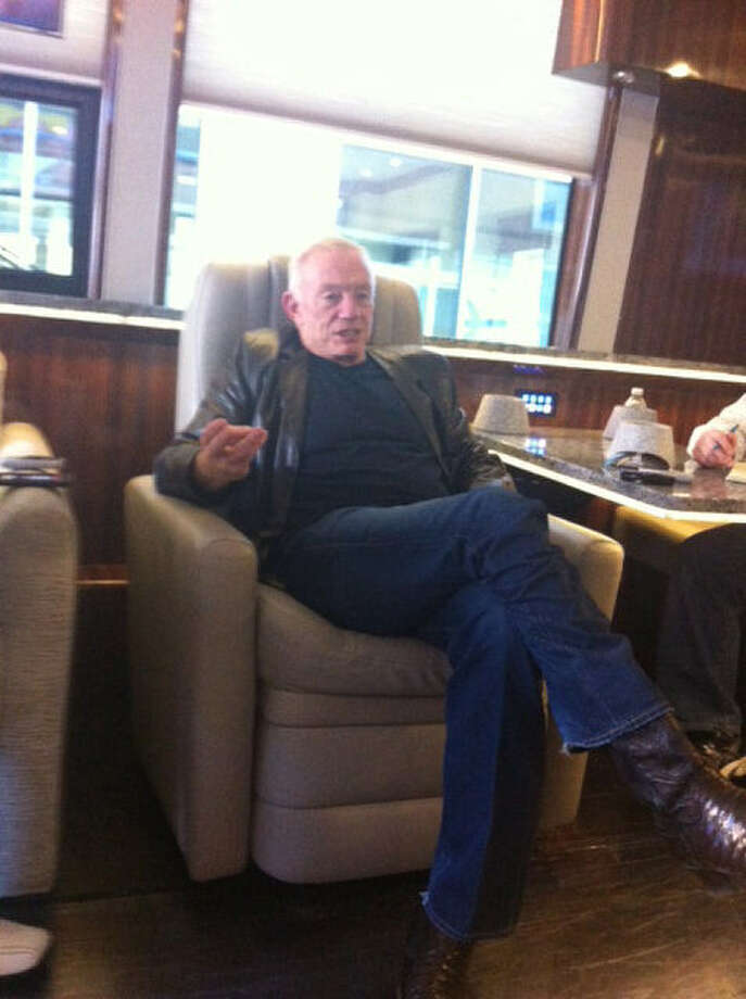 "Cowboys owner Jerry Jones speaks to reporters Saturday in Indianapolis aboard his new multimillion-dollar luxury bus named ""Elegant Lady."" Photo: Tom Orsborn / San Antonio Express-News"