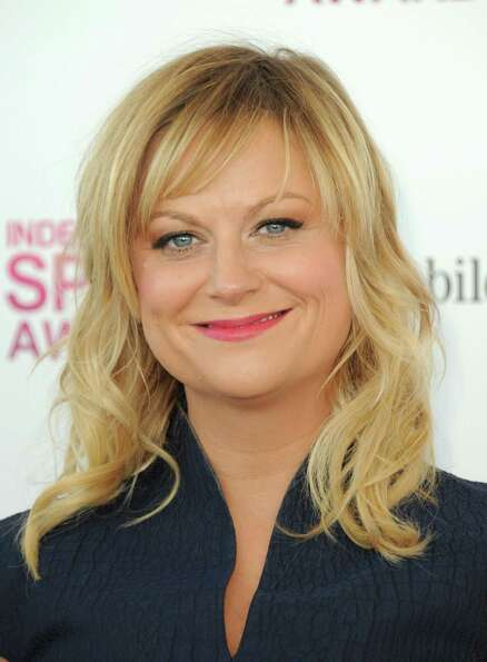 Actress Amy Poehler arrives.
