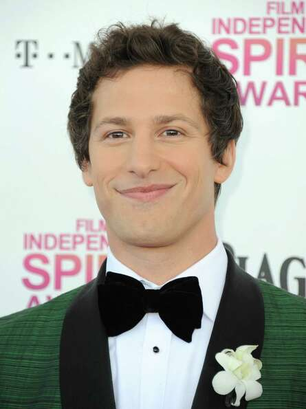 Host Andy Samberg arrives.
